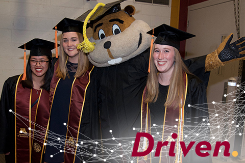Goldy and students at commencement