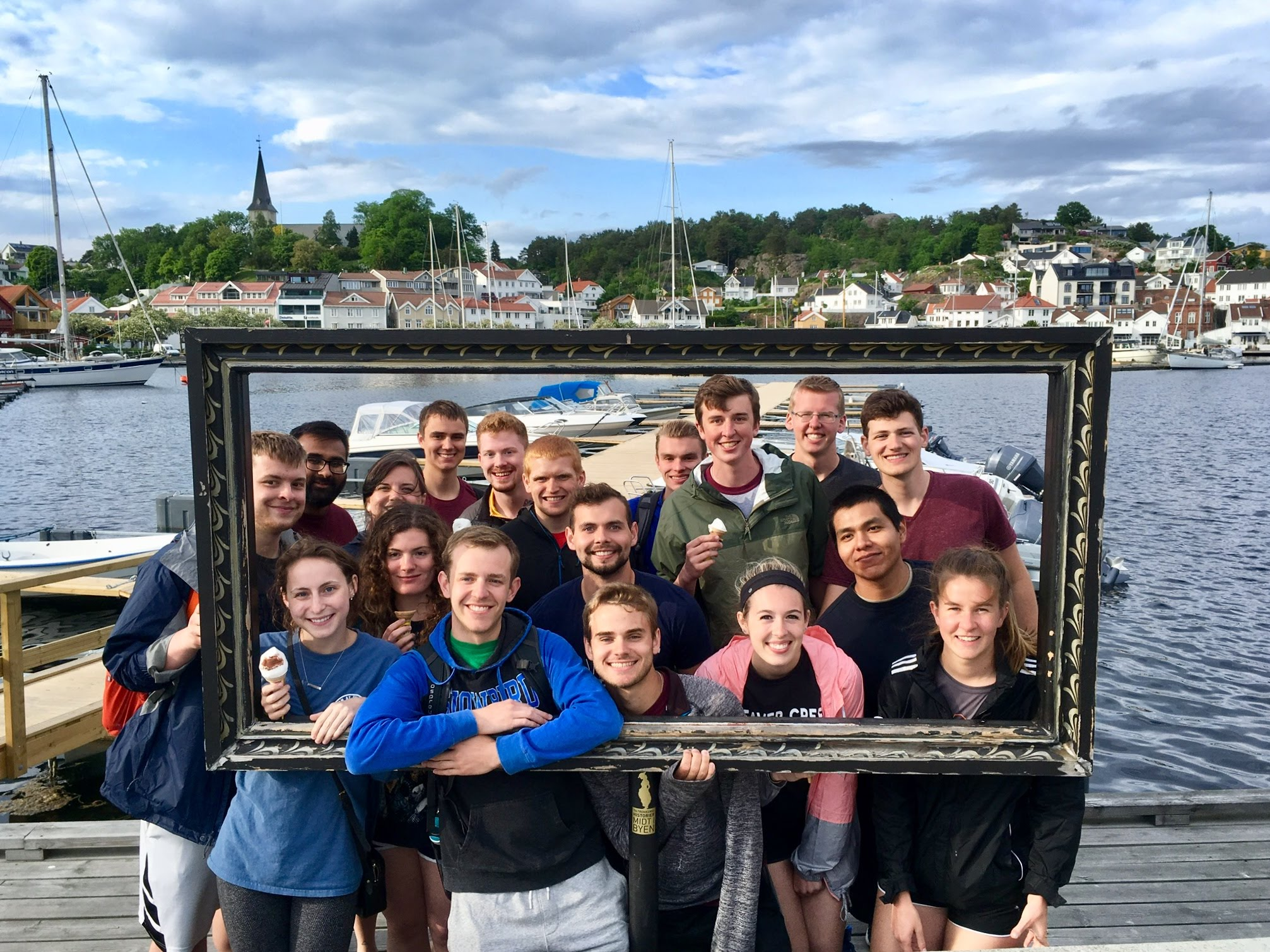 Group of students in front of water in Grimstad, Scandinavia