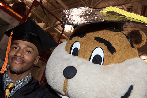 Graduate with Goldy at Commencement