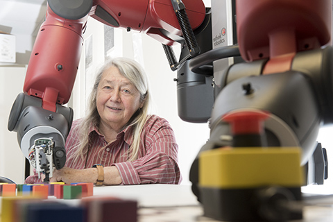 Maria Gini with a robot