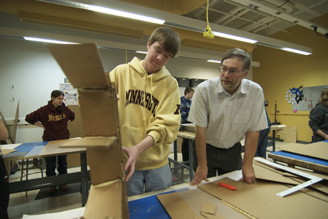 Frank Kelso with students building sleds.