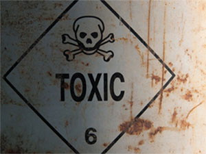 Toxic sign on metal can