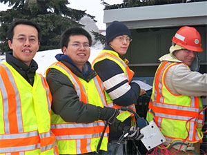 Henry Liu (left) with his research team and a MnDOT technician