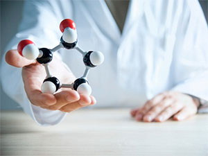 Researcher holding molecular model