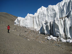 person standing by a glacier