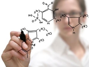 woman drawing a chemistry molecule