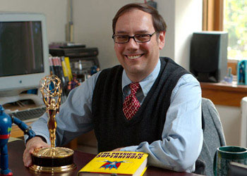 Professor James Kakalios posing with his emmy