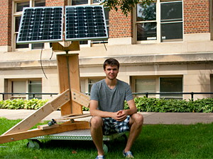 Mechanical engineering senior Scott Morton next to his designs