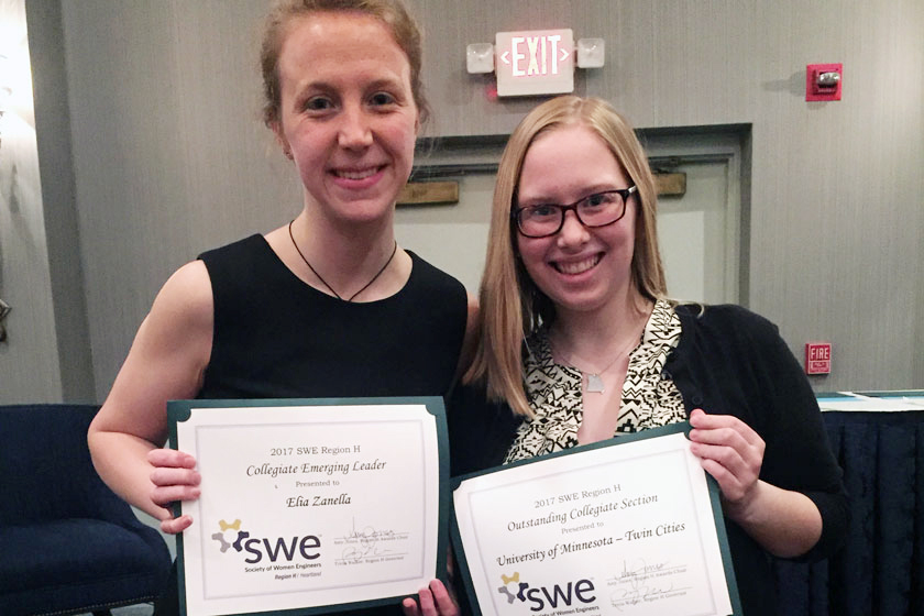Elia Zanella and Kelsey Harper hold their award certificates at the SWE Region Conference
