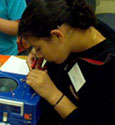 female student participating in technology day camp