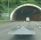 solar car on the road approaching a tunnel