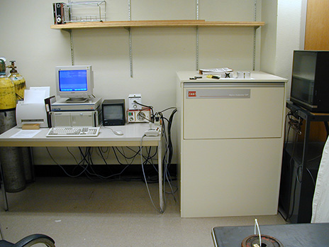 Photo of the NanoIndenter XP Microprobe System in the Tissue Mechanics Laboratory at the University of MInnesota. Shows a computer with the system, which includes an indenter and a positioning microscope.