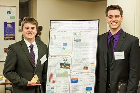 Dow sustainability competition runners-up standing by their poster
