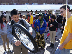 A young student and a bicycle wheel