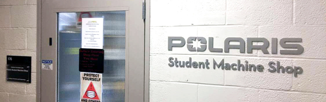 The Polaris Student Shop signage on the wall.