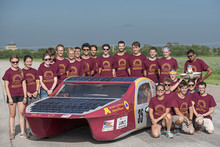Solar vehicle project team photo with their car
