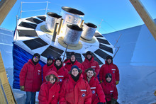 Members of the BICEP collaboration in front of the new BICEP Array Telescope at the South Pole.
