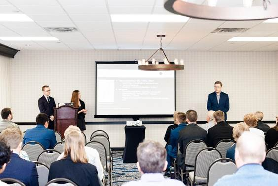 AEM students presenting at a conference